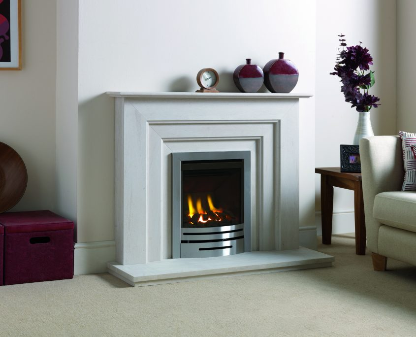 Fireline Seville in Portuguese Limestone, featuring a Matchless Heat Machine DVX gas fire with brushed steel Seville fascia.