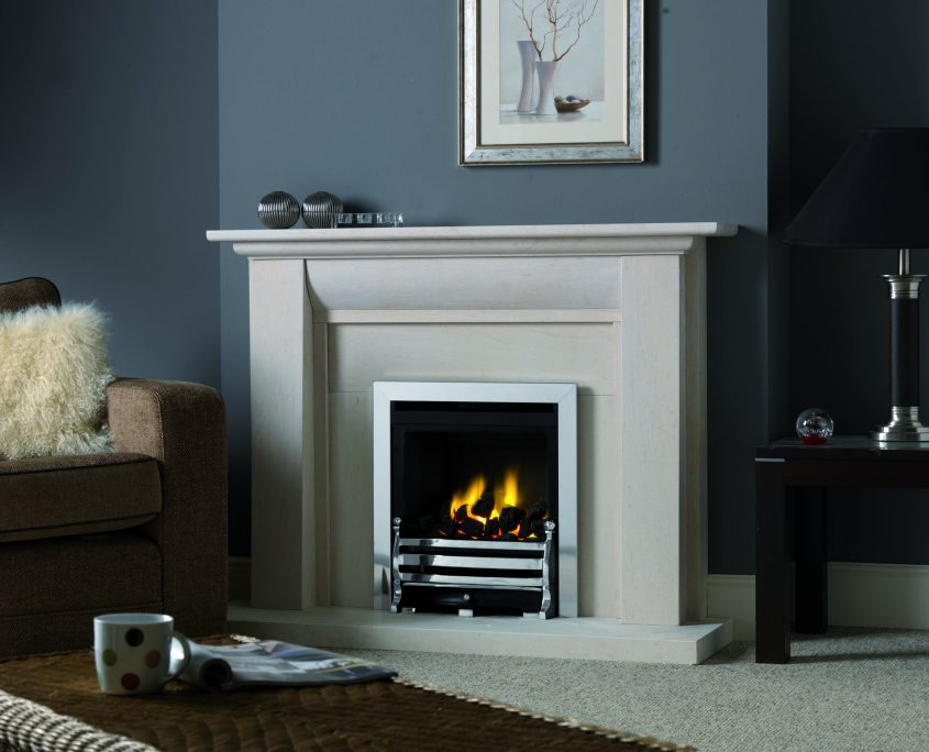 "Fireline Stokesay in Portuguese Limestone, featuring a Paragon Focus HE 18"" gas fire with chrome trim and Antique Bridge fret."